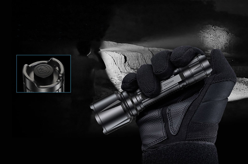 The IR flashlight is held tactically.